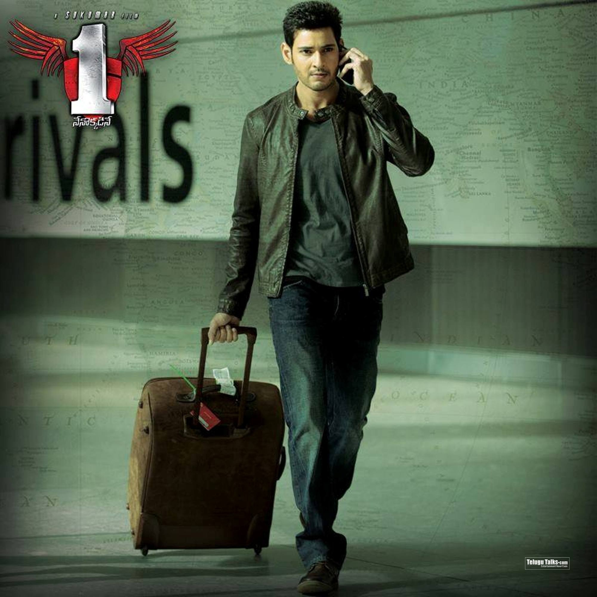 More Stills At  1 Nenokkadine New Stills